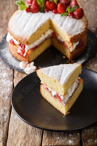 Valokuvatapetti Sliced Victoria sponge cake closeup on a plate. vertical