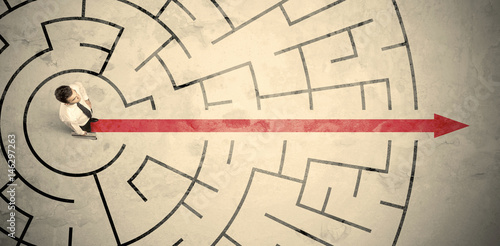 Canvas-taulu Business person standing in the middle of a circular maze