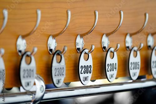 Dressing number plates hang on hooks on the hanger Fototapeta