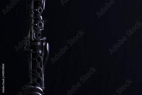 Stampa su Tela Nice image of a clarinet on a black background.