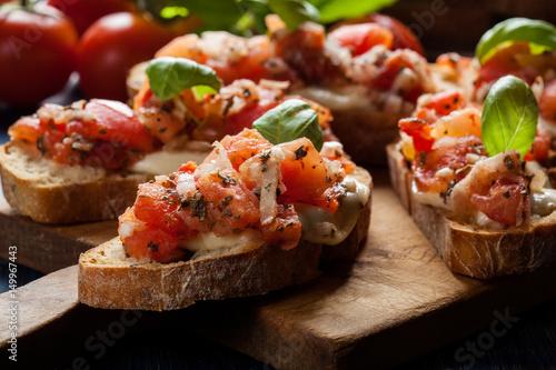 Canvas Print Italian bruschetta with roasted tomatoes, mozzarella cheese and