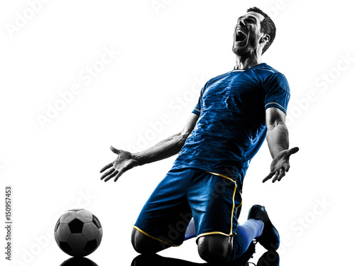 one caucasian soccer player man happy celebration  in silhouette isolated on whi Fototapet