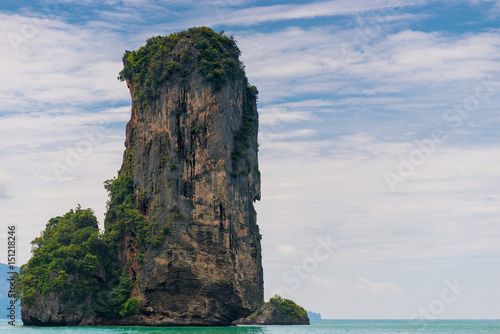 Fotomural High cliff sticks out from the Andaman Sea near the resort of Krabi, Thailand