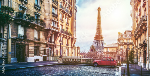 The eifel tower in Paris from a tiny street