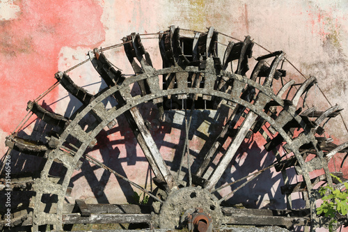 big old wheel of an old abandoned water mill