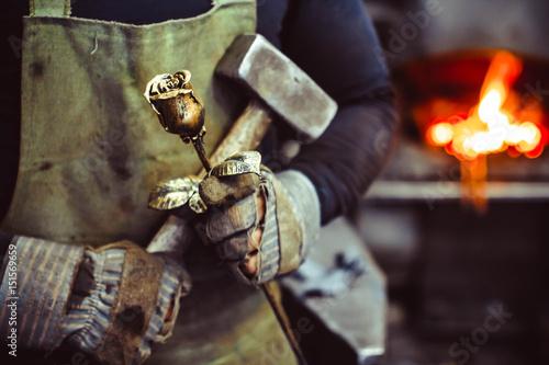 Blacksmith holding forged rose Fototapete