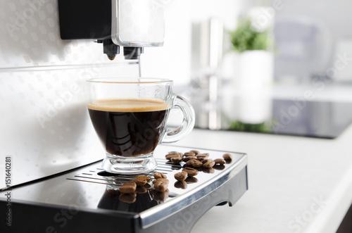 Fotografiet Home professional coffee machine with espresso cup.
