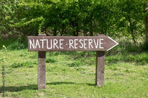 Fotografia Rustic sign for nature reserve in field