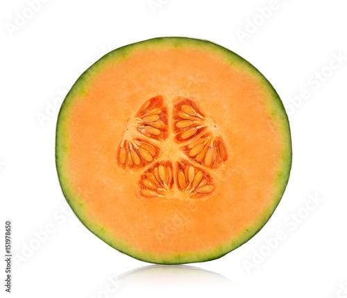Photo A half of cantaloupe melon isolated on white background.