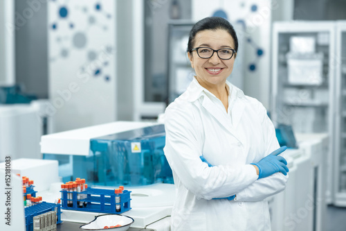 Obraz na plátně Cheerful senior female scientist posing proudly at her lab