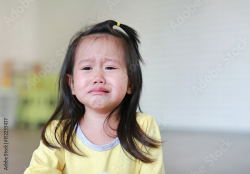 Close up Little kid girl crying with tearful on her face. Fotobehang