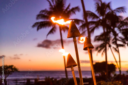Canvas Print Hawaii sunset with fire torches