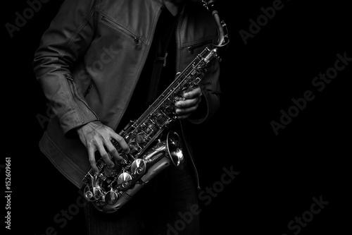 Fotografie, Obraz Jazz saxophone musician in the leather jacket, closeup.