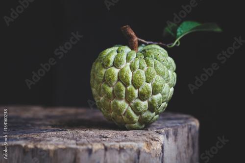 Obraz na płótnie Custard Apple on the old wood