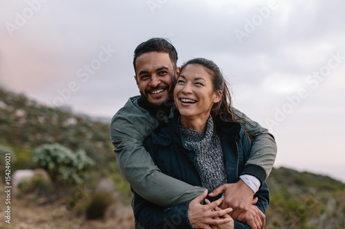 Romantic young couple on country trail