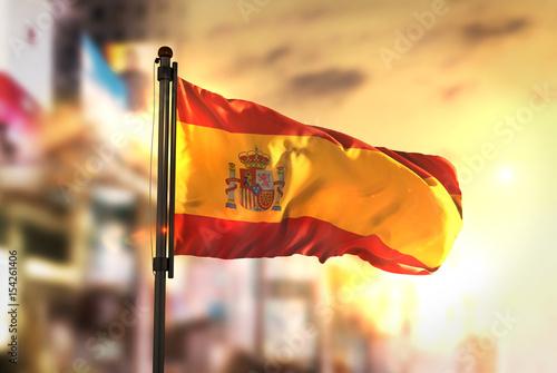 Wallpaper Mural Spain Flag Against City Blurred Background At Sunrise Backlight