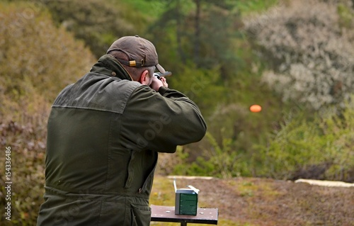 gunman shooting the asphalt pigeon..
