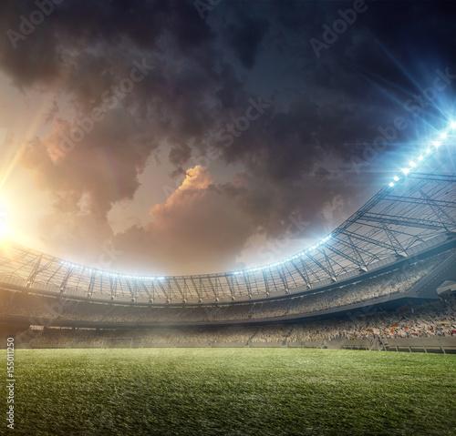 Naklejki na meble Stadion piłki nożnej z oświetleniem zieloną murawą podczas zachodu słońca