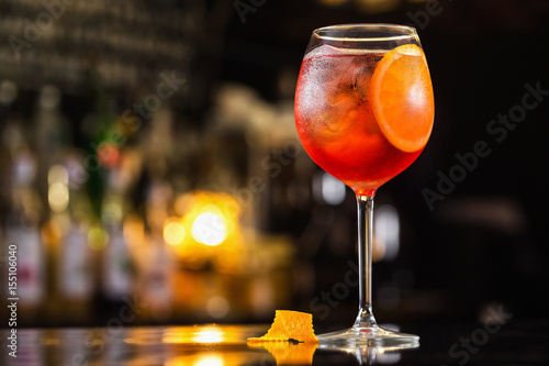Closeup glass of spritz aperol cocktail decorated with orange at bright bar counter background Fototapete