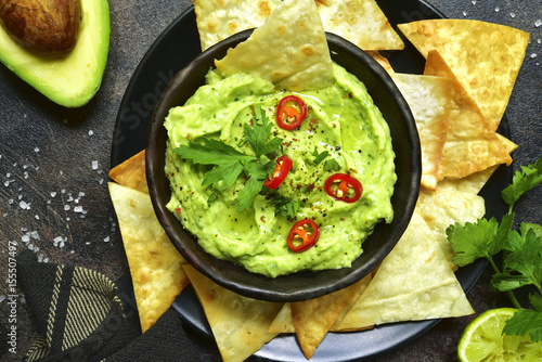 Avocado dip guacamole with tortilla chips.Top view.