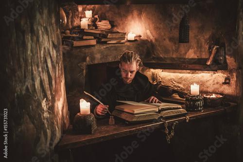 Monk chronicler writes an ancient manuscript Fototapeta