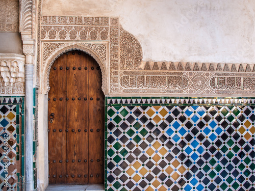 Detail of a door and ornament of Alhambra, Granada, Spain