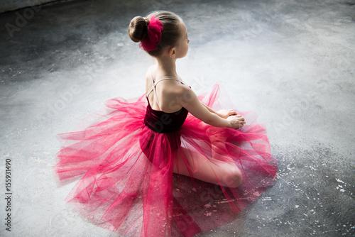 Canvas Print little ballerina sitting on floor