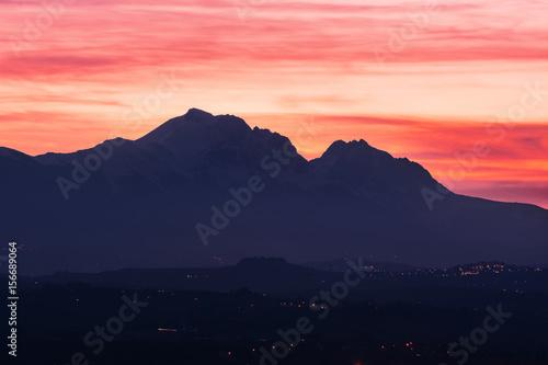 Fotografia, Obraz Silhouette of the Gran Sasso in Abruzzo at sunset resembling the profile of the
