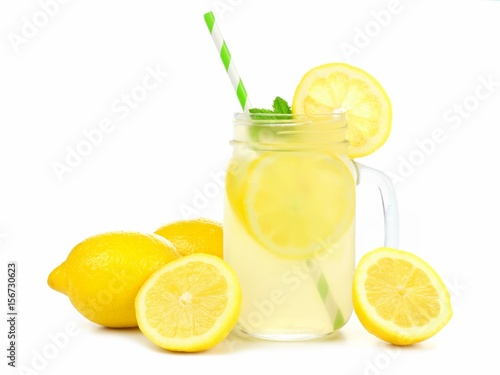 Mason jar glass of lemonade with lemons and straw isolated on a white background Fototapet