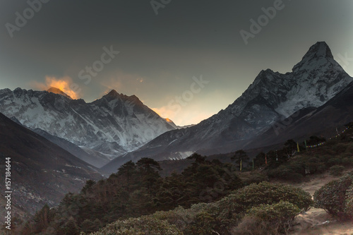 Sunrise in Himalayas. Ama Dablam, Nuptse, Lhotse and Everest in first rays of sun. Two eight-thousander peaks. View from Tengboche. Sagarmatha National Park, Solukhumbu District in Nepal, Asia.