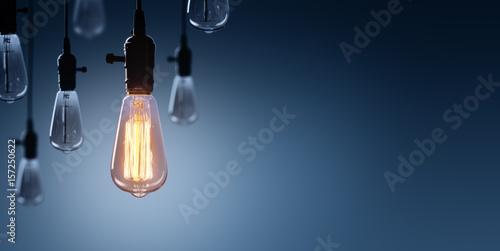 Fotografia, Obraz Innovation And Leadership Concept - Glowing Bulb On Among Bulbs Off