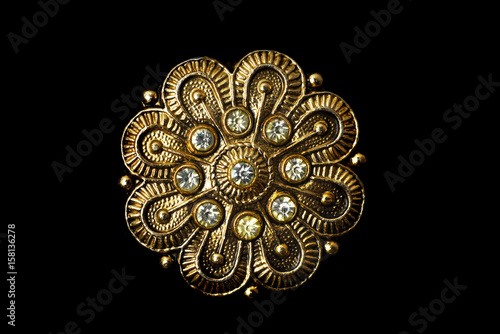 Wallpaper Mural Gold brooch with stones