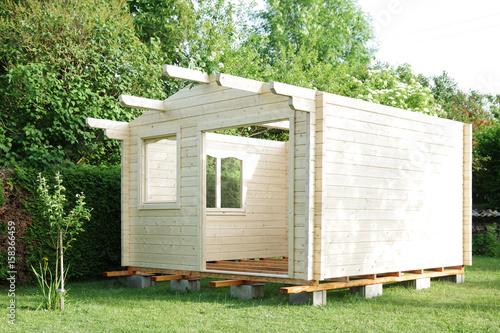 Cuadros en Lienzo Blockhaus, Aufbau eines Gartenhauses