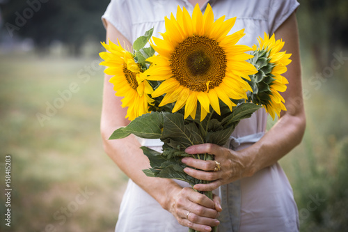 Girl holding sunflowers