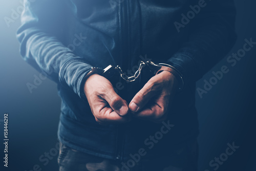 Fotografija Arrested computer hacker with handcuffs