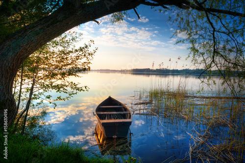 Fototapeta Rowing boat floating over the Lake Selment Wielki waters