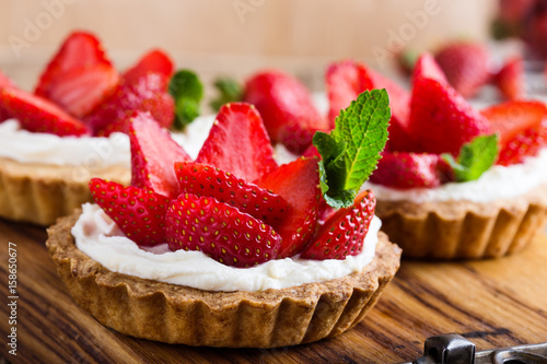 Fényképezés Strawberry shortcake pies on rustic wooden table