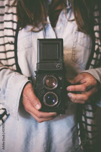 Woman with a retro 120 film camera
