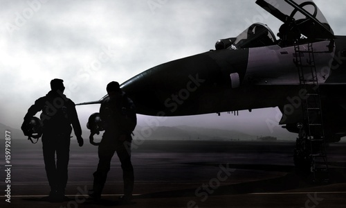 Photo Fighter pilot with supersonic jet on military airbase at dawn