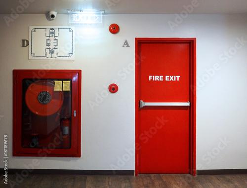 Fire exit emergency door red color metal material. Fototapeta