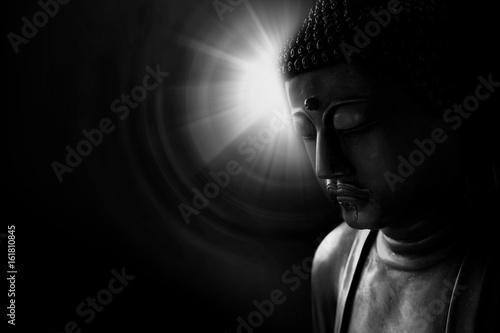 zen style buddha with light of wisdom black and white, peacful asian buddha tao religion art style statue.