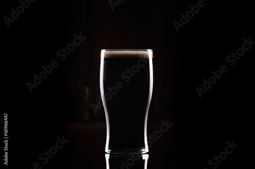 Wallpaper Mural Stout (Guinness like) Beer in pint glass, silhouette with perfect head and dark