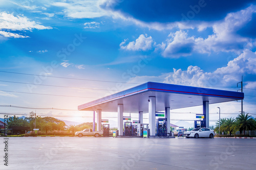 Fototapeta Gas station with clouds and blue sky
