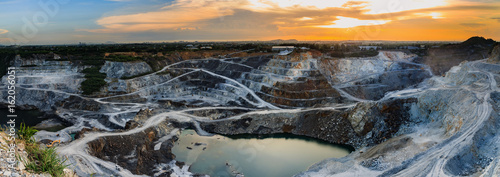 Photo panorama of the quarry mining with beautiful sunlight and cloudy sky Aerial view