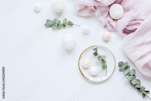 woman desk with plant and marsh-mallow in spring desing on white background flat lay mock up