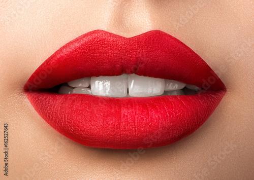 Stampa su Tela Close up view of beautiful woman lips with red matt lipstick