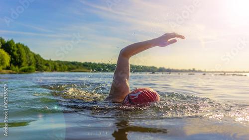 Obraz na płótnie Woman swimming in a lake