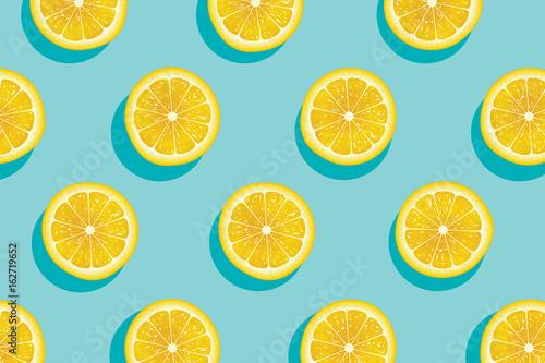 Obraz na plátně Slices of fresh yellow lemon summer background.