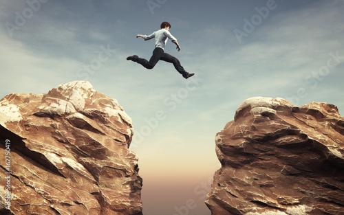 Young man jumping Fototapet