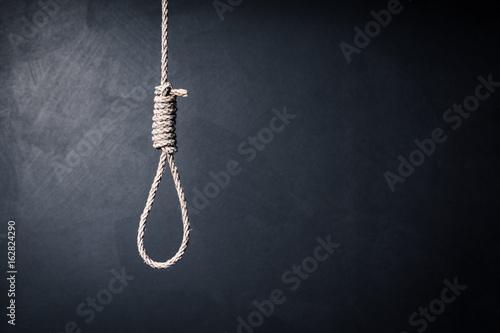 Fotografija the noose against sullen background, failure or commit suicide concept